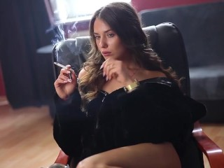 The brunette girl smokes a cigarette. - Hot body, sexy tits and sexy belly!