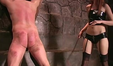 mistress in latex underwear knitted a slave and whipping hard