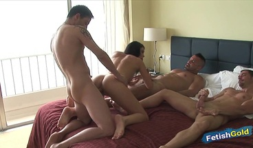 Stunning brunette gets double penetration in hot gangbang