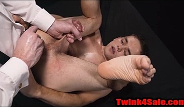 Twink Oiled up and fucked with a glass dildo