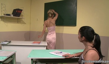 Bound slave gets fingered after footfetish in the classroom
