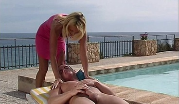 Sexy blonde beauty is fucked on a patio chair by the pool