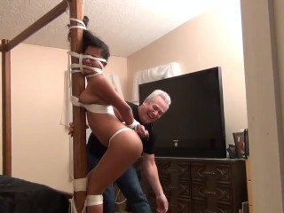 Drea tied to bed post and spanked