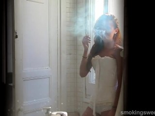 A sweet smoker girl smokes a cigarette. - Sexy flat belly and sexy tits!