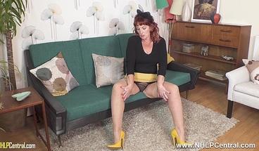 Randy mature redhead wanks in bullet bra nylons garters heels