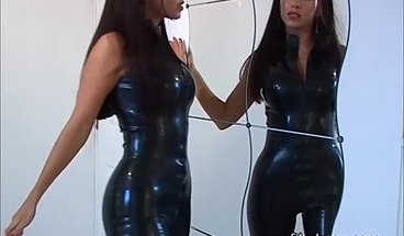 Sexy latex softcore model Justine flashes big tits and high