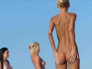 At the Nude Beach Her Jealous Friends Play a Game to Trick this Babe Into Flashing Her Open Pussy