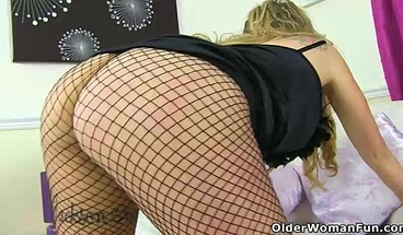 English milf Classy Filth looks so inviting in fishnet tights
