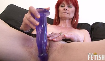 Redhead granny gets her tight cunt drilled by black dude after playing with toys