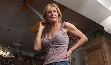 Horny MILF enjoys an earth shattering orgasm
