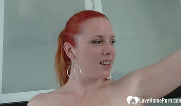 Fiesty redhead plays with her favorite toy