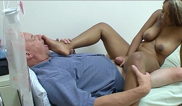 Gorgeous ebony beauty handles his thick cock with her feet