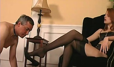 Slave licks Mistress's dirty soles and swallows her spit.