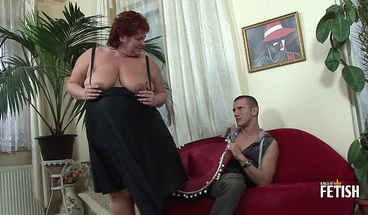 Redhead BBW with big ass enjoys riding a young big cock