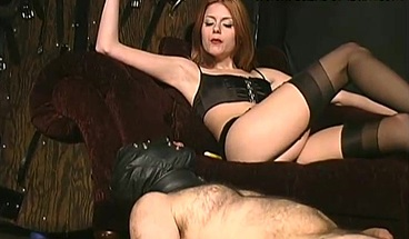 Gorgeous goddess smokes and spits in the mouth of a slave.