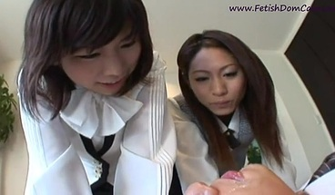 Two Japanese schoolgirls spit in the face of the teacher.