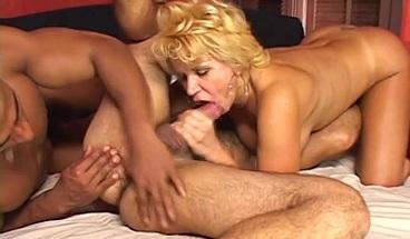 Busty MILF enjoys a steamy bisexual threesome