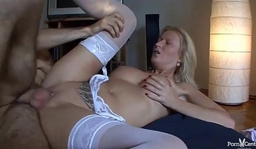 Stunning blonde with large tits is fucked from behind