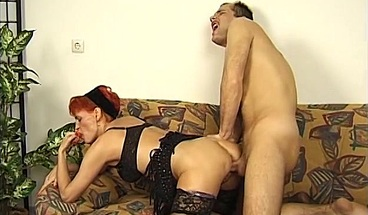 Kinky redheaded cougar loves his thick throbbing cock