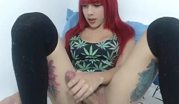 Tattooed Redhead Shows Off Thick Dick