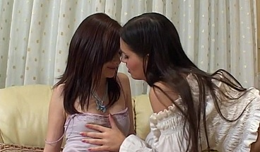 Brunette lesbians lick and tease one another's wet pussies