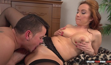 Redhead in stockings gets surprised by a cock