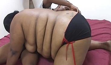 Thick ebony beauty sucks down a big cock before fuck